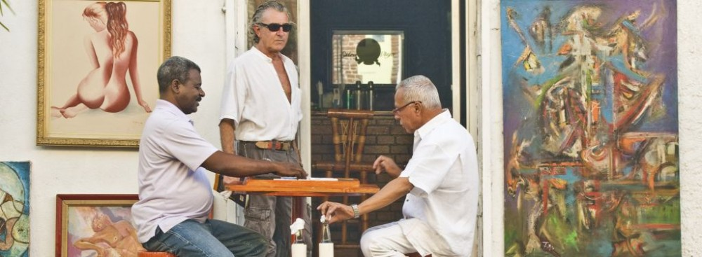 Locals playing dominos in Santo Domingo, Dominican Republic © Dlrz4114 | Dreamstime