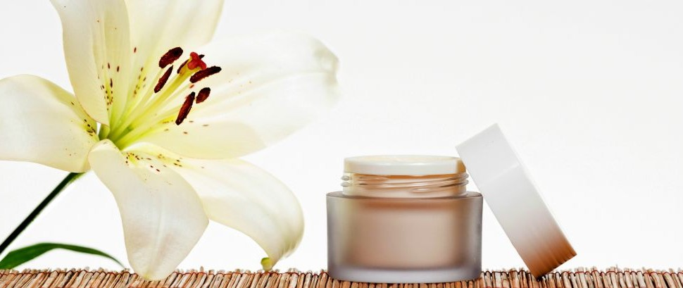 Skincare Cream Jar on Bamboo with a Flower © Narstudio | Dreamstime 38802607