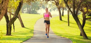 Athletic Fit Woman Jogging Outdoors in the morning in a park © Epicstock | Dreamstime 37174311