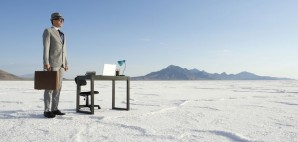 Businesman standing mobile office desk outdoors white desert © Lazyllama | Dreamstime 43603157