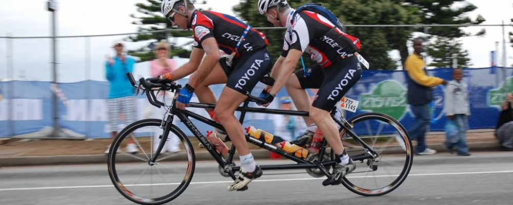 Francois Jacobs And Jurie Krige Of South Africa Racing A Tandem Bike For The Ironman Triathlon