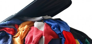 Overstuffed luggage suitcase clothes packing vacation travel © Maria Barski | Dreamstime 11889628