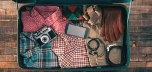 Vintage Hipster Packing Clothing © Andrea De Martin | Dreamstime 55622254
